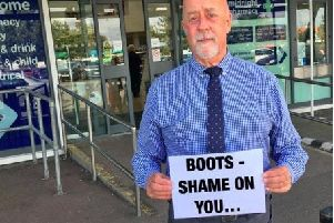 Cllr Robin Maxted outside Eastbourne Boots