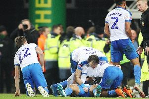 Pompey's players mob Andre Green following his last-gasp FA Cup winner at Norwich last season. Picture: PinPep Media/Joe Pepler