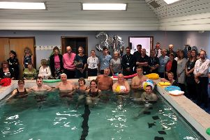 Staff and patients celebrate 30 years of Aquatic Physiotherapy at Eastbourne DGH (Anna Carter Lead Aquatic Physiotherapist centre in pool)
