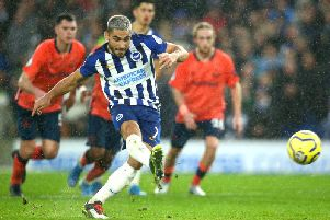 Brighton and Hove Albion striker Neal Maupay calmly slots home the penalty after a controversial VAR decision at the Amex Stadium