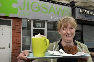 """Kirstie Harding outside her and Ron's Cafe """"Jigsaws"""" for people with autism and learning difficulties. The cafe is in Seaside, Eastbourne (Photo by Jon Rigby) SUS-190905-104248008"""