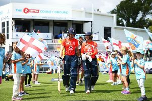 Amy Jones and Danni Wyatt walk out to bat for England at The 1st Central County Ground last summer
