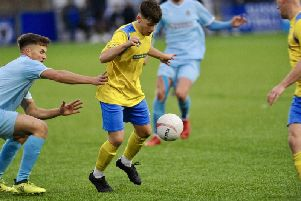 Brad Santos in action for Lancing. Picture: Stephen Goodger