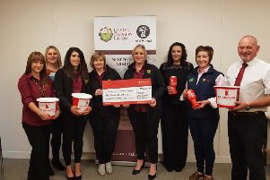 Pictured at the handover of the funds raised by NE Armagh Group for the UFU Centenary Charity are NE Armagh Group Managers Avril Macauley and Lawson Burnett, Roberta Simmons UFU Membership Development Officer and office staff Martina, Kirsty, Sonia, Lee and Kerry.