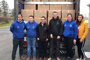 Members helping to load a lorry with shoeboxes