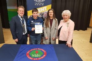 YFCU president James Speers, Mrs Joan Christie CVO OBE, Her Majesty's Lord-Lieutenant for the County of Antrim with 12-14 age group winners - Kilraughts YFC