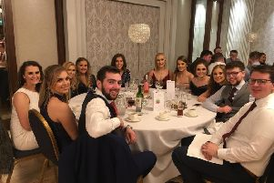 A table of Lisnamurrican YFC members ready for the four course meal at The Dunadry Hotel