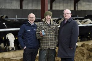 Gerry Hackett, from DAERA, with Dale Farm dairy farmer James Lindsay and Neil McKeown, Neueda. Picture: Michael Cooper