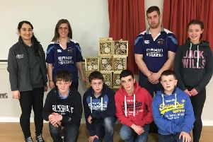 Members and their bug house hotels with Orlagh from Ulster Wildlife/Grassroots