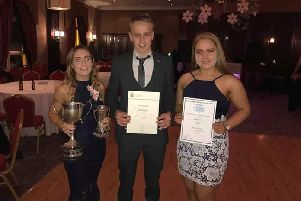Amy Knight, Gareth Knight and Rachel Belshaw with their county dinner awards