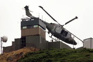 A British army watchtower on the border in south Armagh before it was dismantled in 2005: 'The supply of weapons to the Provisionals was almost entirely by routes that passed through the Republic'
