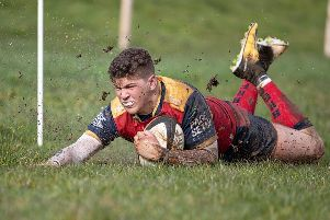 Ballyclare's Owen Kirk goes over for one of his two tries against Armagh