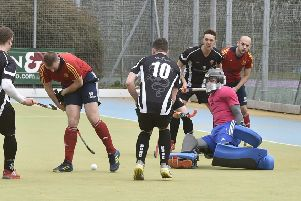 Action from City of Peterborough seconds (red) and Bourne Deeping firsts in the East Premier B Division. Photo: David Lowndes.