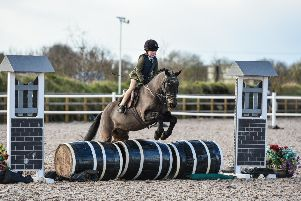 Lily Murphy riding Buzby, winners of the 60cm Working Hunter