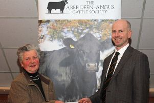 Guest speaker Dr Cahir McAuley BVMS MRCVS receives a token of appreciation from NI Aberdeen Angus Club secretary Cathy O'Hara. Picture: Julie Hazelton