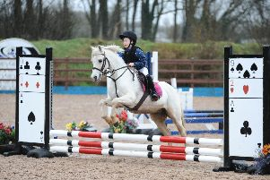Ellen McNabb riding Buddytwoshoes (St Patricks Primary School) 1st in the Primary 50cm Individual