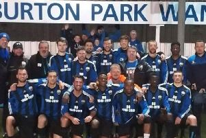 The Burton Park Wanderers squad were joined by Bo Patricks son and club chairman Mark (far left) as they posed for the camera following their 2-0 win over Sileby Rangers in their first home match since the passing of the club stalwart