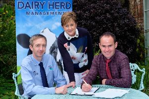 Discussing the agenda for Holstein NI's 20th AGM on Monday 8th April are, from left: Gary Watson, producer services manager, Dale Farm, sponsor; Julie Wallace, PR and events co-ordinator, Holstein NI; and Jason Booth, chairman, Holstein NI. Photograph: Columba O'Hare/ Newry.ie