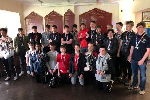 Borough Under 15s were presented with their trophy by 19-times capped England international Billy Twelvetrees (in red in the back row).