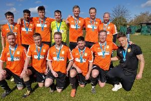 Thorney FC with their Peterborough Premier Division runners-up medals.