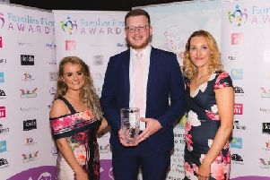 Ashley McMaster, Michael Campbell and Claire Duddy from Mid and East Antrim Borough Council collecting the award for Best Family Park.