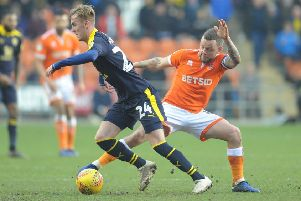 Blackpool's Jay Spearing vies for possession with Oxford United's Mark Sykes