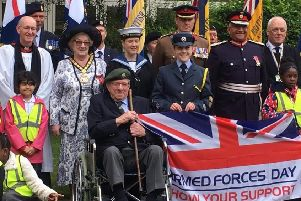 Leicestershire County Council chair, Councillor Pam Posnett, with he father-in-law, Jim Posnett, a 100-year-old war veteran, and other guests at Monday's Armed Forces Day ceremony at County Hall EMN-190626-103356001