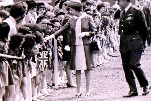 HM the Queen on her Royal visit to RAF College Cranwell in 1970 meets local Brownies on her walk about. EMN-190907-152529001