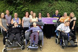 Station Road care home manager Karen Parker-Farthing, back row, second from right, with her support team and three people supported by the service.