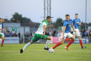Jimmy Muitt runs at Brandon Haunstrup in the second half / Picture by Tommy McMillan