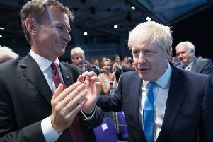 (left to right) Jeremy Hunt and Boris Johnson at the Queen Elizabeth II Centre in London as it was announced Mr Johnson is the new Conservative party leader, and will become the next Prime Minister. Photo: Stefan Rousseau/P/A Wire