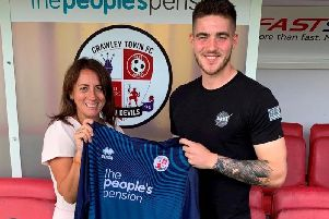 New Reds keeper Alfie Jones and Operations Director Kelly Derham. Picture courtesy of Crawley Town Football Club