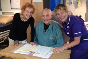 Celebrating the award of the Investing in Volunteers UK quality standard, Sussex Community NHS Foundation Trust volunteer Irene Gay and Marianne Marden-Grove, ward matron of Crowborough Hospital, with a patient