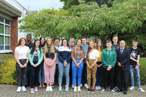 Some of Loreto College's top achievers at GCSE with College Principal Mr Michael James