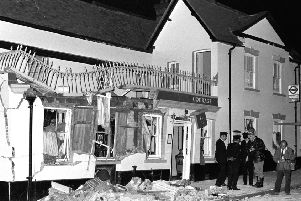 The aftermath at the Horse and Groom pub in Guildford, Surrey, where an IRA bomb attack killed four soldiers and a civilian and injured dozens more.