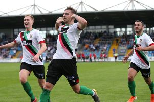Robbie McDaid celebrates finding the net for Glentoran against Ballymena United. Pic by INPHO.