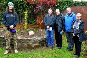 Ben and Liam from the Creggan Men's Group pictured with Fr Joseph Gormley PP, Venerable Robert Miller and Rev Kate McAteer at the planting of a weeping willow sapling, in the garden of the Creggan Community Collective, marking World Suicide Prevention Day in 2018.   DER3618GS003