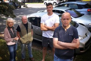 Brian Ellis with other disgruntled residents who are fed up with motorists using their car park on Chapel Street, Melton EMN-190918-105440001