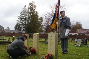 Students from De Aston laid poppy crosses at each of the town cemetery's war graves EMN-191011-134950001