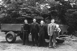 Pictured left to right  in 1947 at Crakemarsh are Bill Hirst MBE, employee number one Arthur Harrison, employee number two Bert Holmes and Company Founder Joseph Cyril Bamford with a young Lord Bamford in his arms.