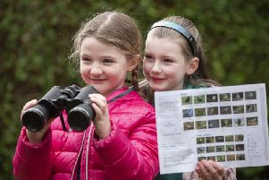 Friends Sophia and Sophie, pictured in Belfast, getting ready to take part in the RSPB Big Garden Birdwatch. Picture: Mark McCormick