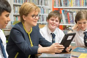 First Minister Nicola Sturgeon with students at the launch of Scottish Book Trusts new app, Bookzilla. Picture: Alastair Watson