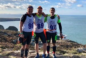 David Shiels, Mike Scott and Clem Willis in North Wales after completing the SwimRun event