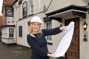Sian Griffiths, landlady of the Bell pub in Grimsbury looks over the plans for the refurbishment NNL-190225-113856001