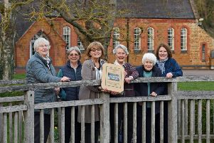 Team effort...from left, Hazel Wallace, Jenny Sandars, Meriel Godfrey president, Helen Roberts team leader, Jean Clarke and Pat Nelson of Medbourne cum Holt WI with their Centenary Book which is launched on Friday 5th April at Medbourne Village Hall.'PICTURE: ANDREW CARPENTER NNL-190104-102707005