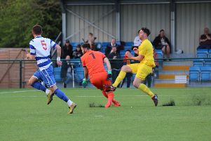 Ricky Johnson beats Oxford City keeper Craig King to give Banbury United the lead. Photo: Steve Daniels NNL-190430-204707002