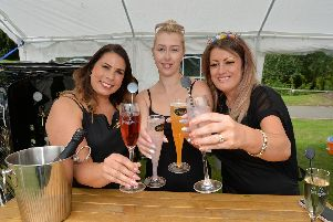 Centre, competition winner Melissa MIlls with prosecco Queen's Carrie Milligan and Sally Thomas. PICTURE: ANDREW CARPENTER