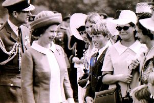 The Queen meets well wishers in the crowd at RAF College Cranwell when she visited to celebrate its 50th anniversary in June 1970. EMN-190628-094249001