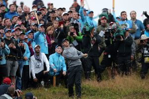 """An expectant crowd watches Rory McIlroy chip from the rough on the 17th hole in the Open at Royal Portrush in a crucial moment last evening. """"Even the way that he failed  ' seeming to be defeated by nerves at the huge task he had set himself of winning at home 'showed a vulnerable side to someone who can be supremely confident in his own gifts,"""" writes Ben Lowry  Photo: Richard Sellers/PA Wire"""