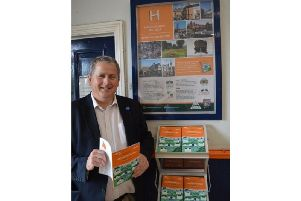 Cllr Phil King with the posters and guide at Market Harborough station